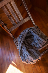 Woollen scarf lying on wooden chair