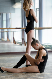 Two young ballet dancers in studio during the break