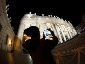Tourist with pad shooting st. peters basilica in vatican city