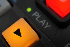 "Macro shot of the ""play"" and ""record"" buttons"