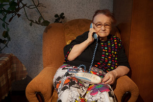 Elderly woman talking on the home phone