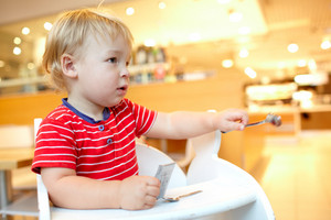 Little boy in the restaurant