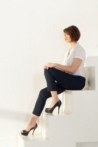 Relaxed businesswoman sitting on stairs with eyes closed