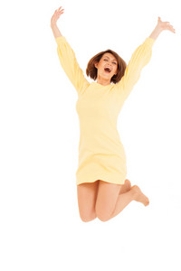 Smiling adult woman jumping with hands up