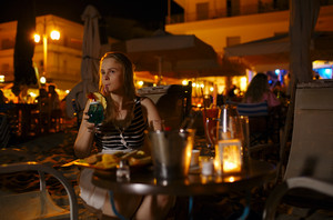 Woman enjoying a drink in a pub or restaurant