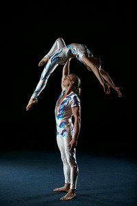 Circus artists perform different tricks