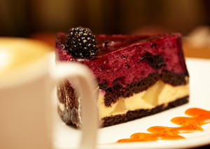 Cheesecake with blackberry on a plate