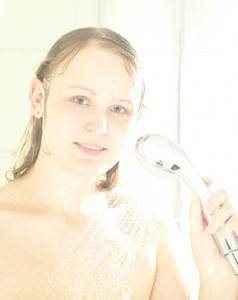 Caucasian female showering