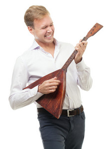 Excited young man playing balalaika