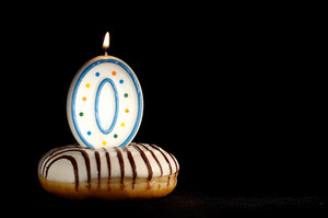 Candle o in the doughnut  new beginnings