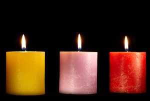 Three candles on black