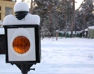 Closeup of old-style railway traffic lights.
