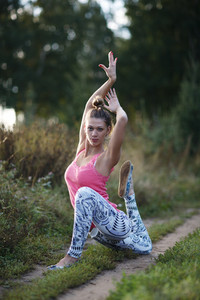 Supple graceful young woman exercising outdoors