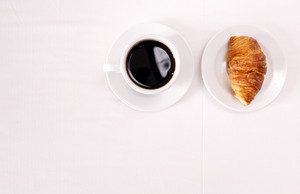 Coffee and croissant for breakfast