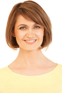 Headshot of beautiful woman in yellow smiling at camera