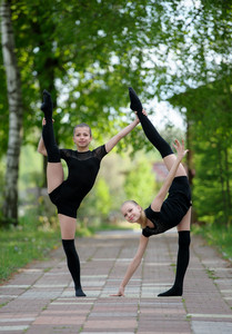 Two teen rhythmic gymnasts