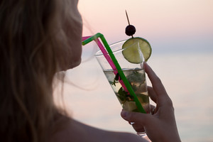 Woman drinking mojito cocktail