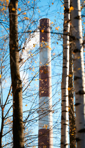 Factory chimney and trees