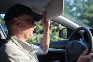 Senior driver hiding from the sun