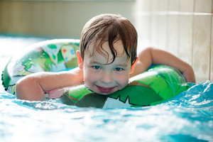 Young boy in inflatable tube swimming