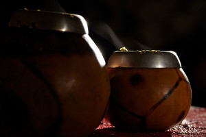 Two yerba mate calabashes with smoke
