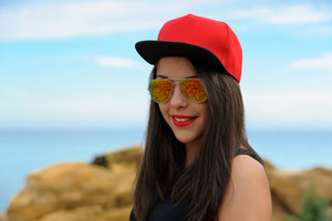 Young smiling girl in red cap