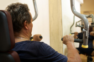Man exercising on shoulder press machine