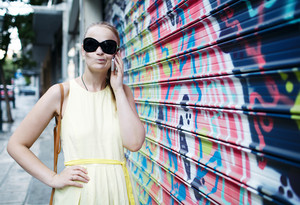 Woman in sunglasses chatting on a mobile