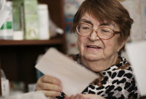 Elderly woman reading a letter