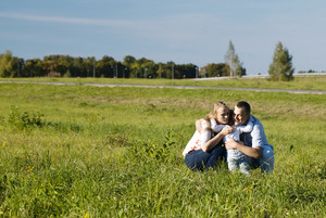 Family of three having fun outdoors
