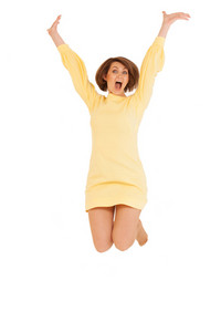 Adult woman in yellow dress jumping