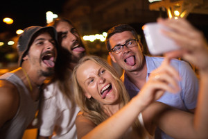 Young people taking crazy selfie with mobile