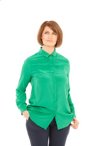 Portrait of adult woman in green blouse looking up