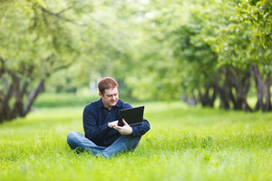 Man working with notebook in the park