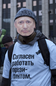 The protester with putin's mask on his face