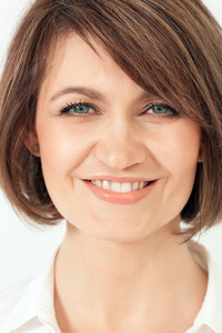 Headshot of adult woman with toothy smile