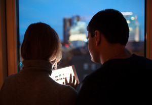 Couple using tablet pc in the evening