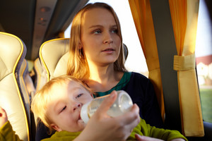 Mother with kid in the bus