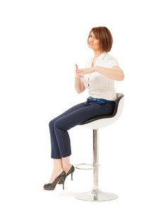 Elegant businesswoman talking while sitting on chair