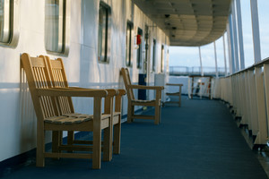 Wooden chairs on the deck of cruise liner