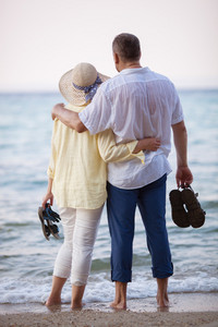 Couple embracing and looking at sea