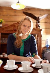 Woman makes coffee