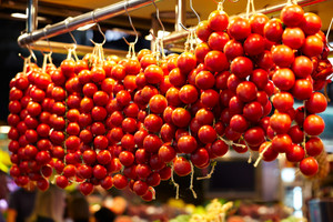 Tomatoes at a stand in the boqueria market