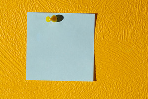 Pink sticker on the yellow wall