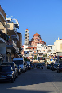 Narrow street with parked cars in greece