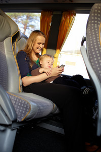 Mother and kid are playing game on the phone