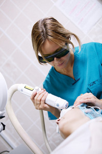 Patient undergoing skin treatment with a laser