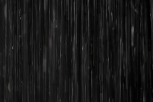 Rain on black abstract background