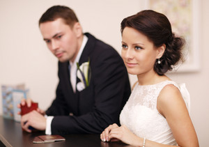 Couple at a reception desk with their passports