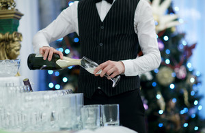 Waiter pouring glasses of champagne